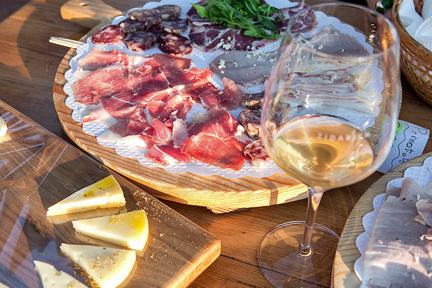 karstic prosciutto, cheese and wine for tasting at an osmiza