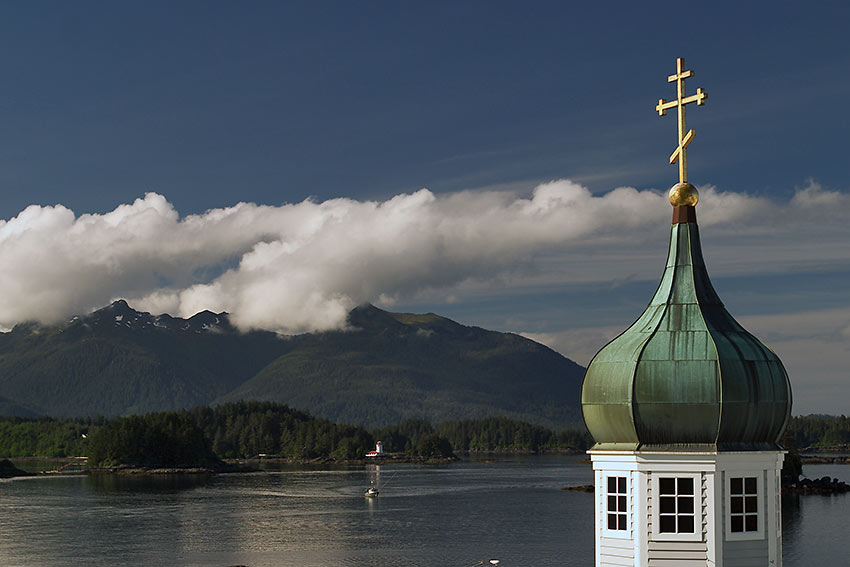 the spire of St. Michael's Cathedral with Sitka Sound in the background