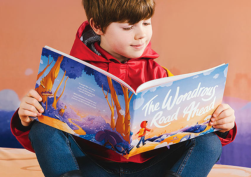 child with Wonderbly's 'The Wonderous Road Ahead'