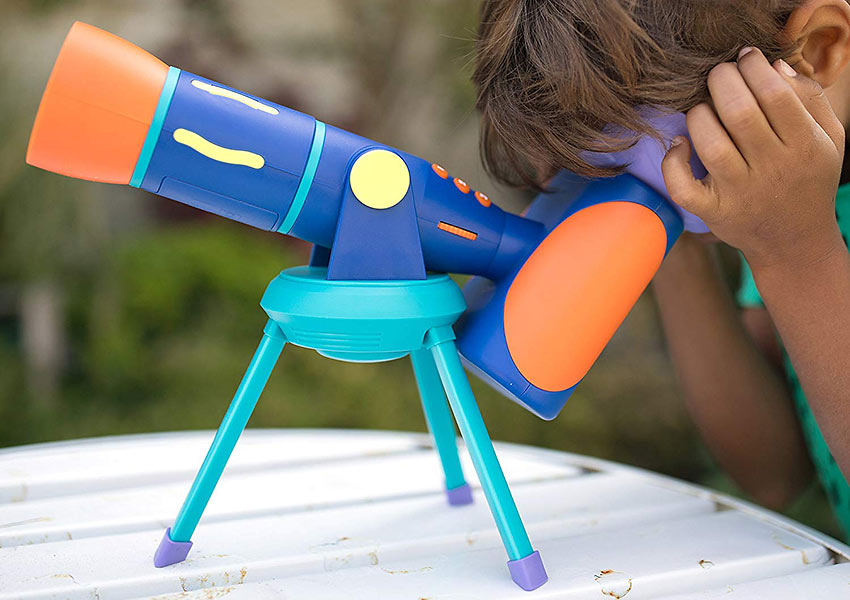 child with GeoSafari Jr. Talking Telescope
