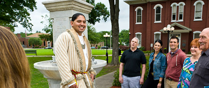 Cherokee Nation tour guide with visitors