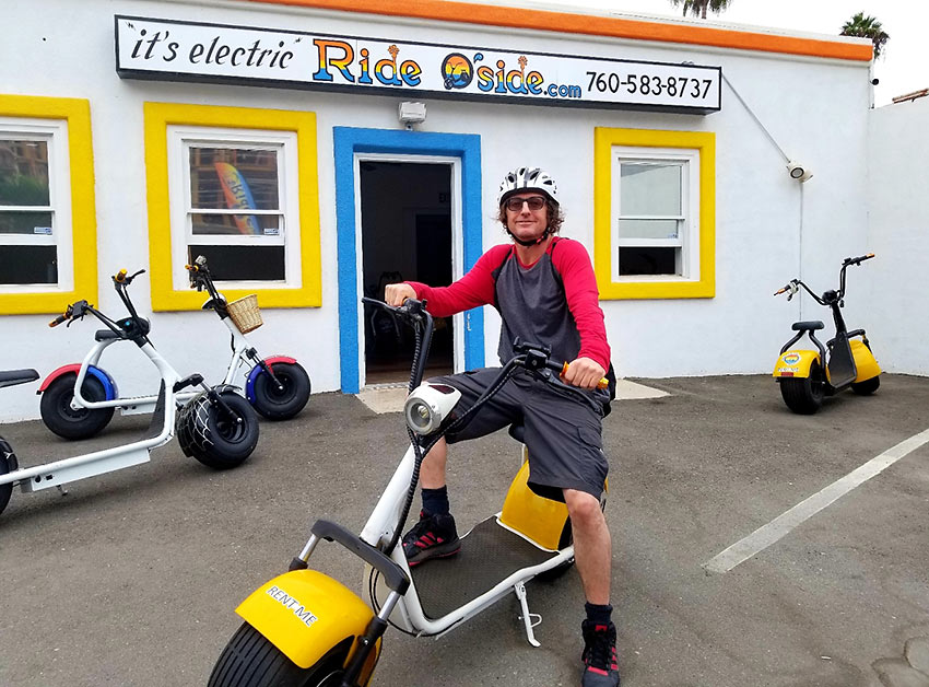 writer with fat tire electric scooter, Oceanside