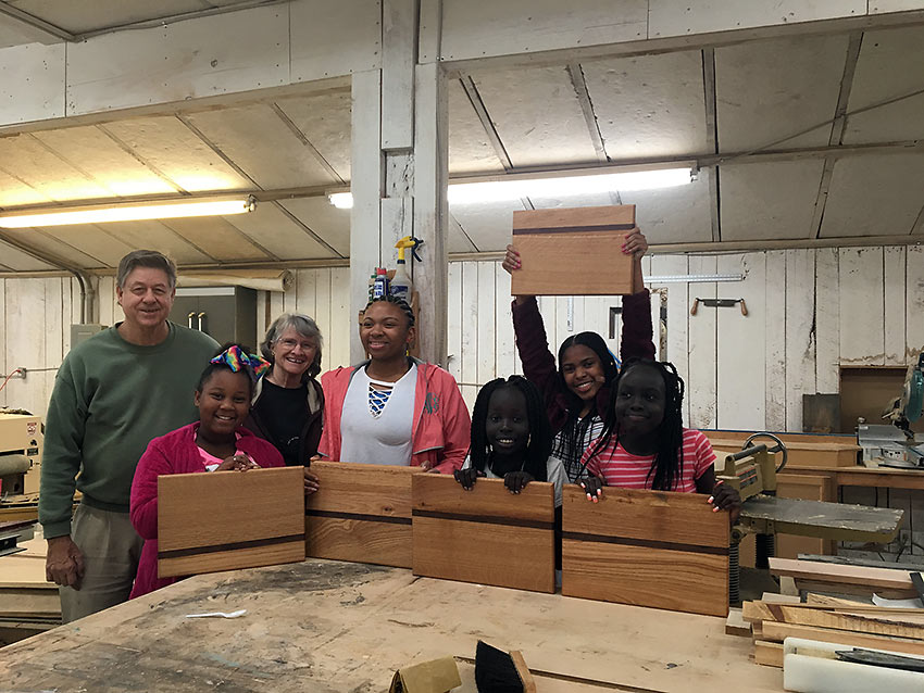 the Landrys with girls and their cutting boards, Kids Are People program