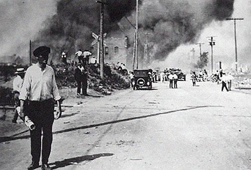 burning neighborhood in Greenwood, Tulsa race riot 1921