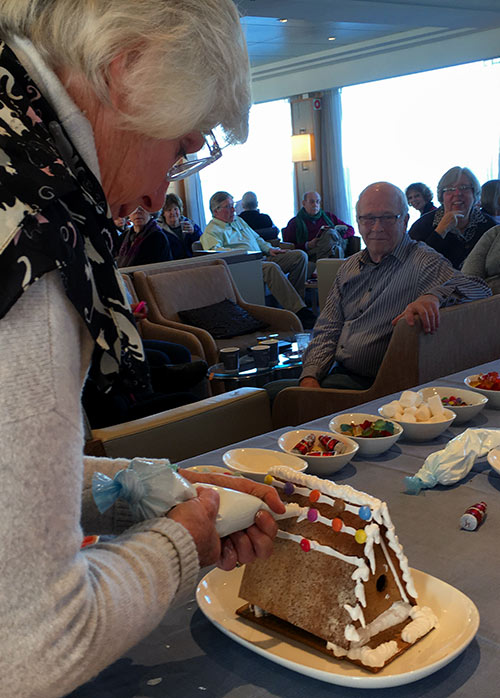 passengers try their hands at making gingerbread houses aboard the Viking Vili