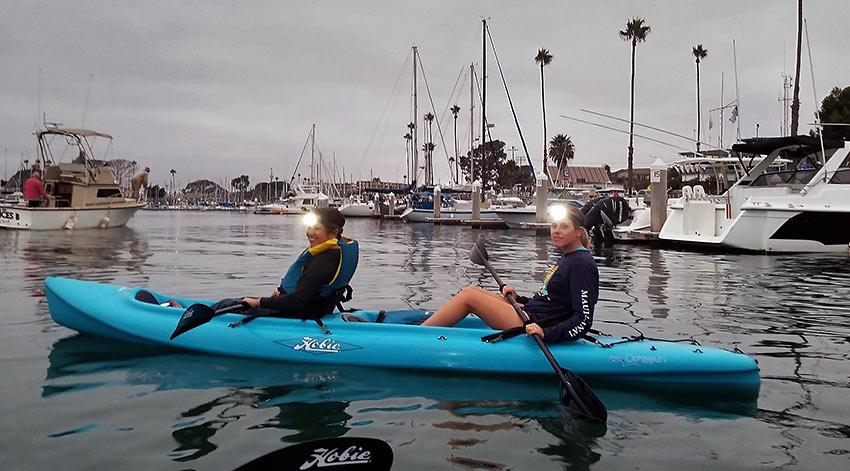 moonlight kayak paddlers at Oceanside Harbor