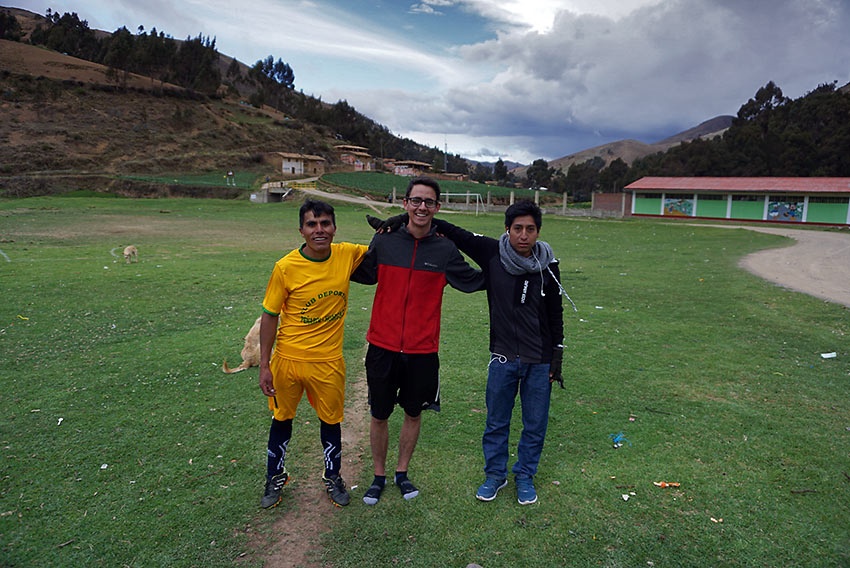 writer after a soccer game with two Peruvians