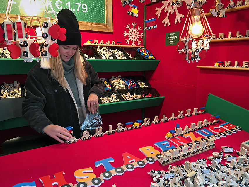 Vienna Christmas market stall selling wooden train cars in letters of the alphabet