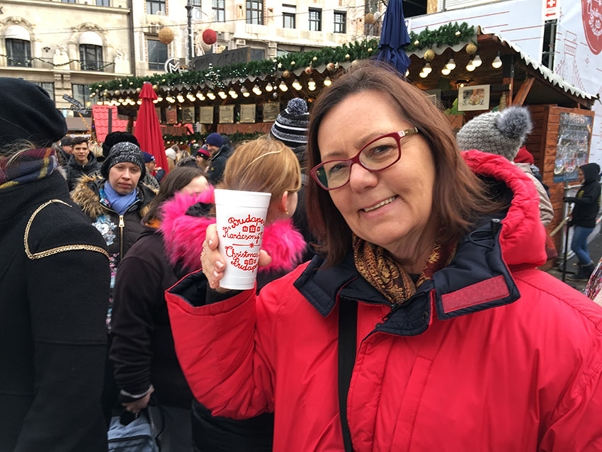 author with mulled wine at a Christmas market in Budapest, Hungary