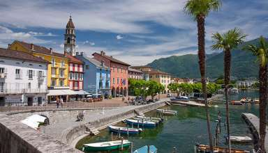 colorful Mediterranean-style buildings along a promenade in Ascona