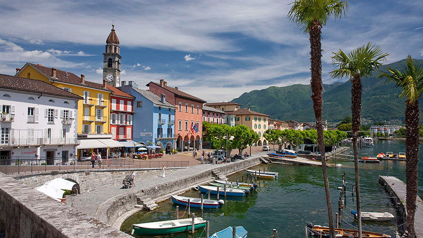colorful Mediterranean-style buildings along a promenade in Ascona