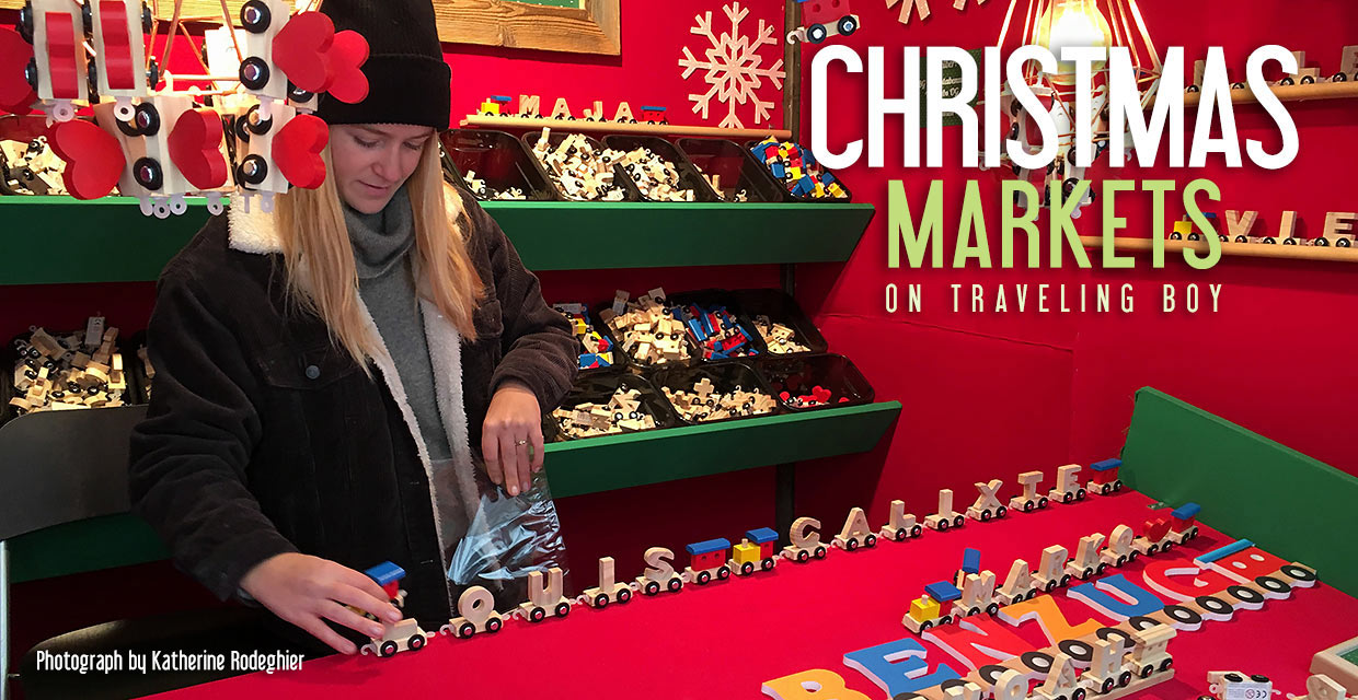 Christmas market stall in Vienna selling wooden train cars in letters of the alphabet