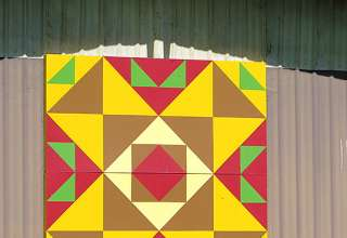 colorful block at a barn on the Rohrer property honors six tribes of Native Americans