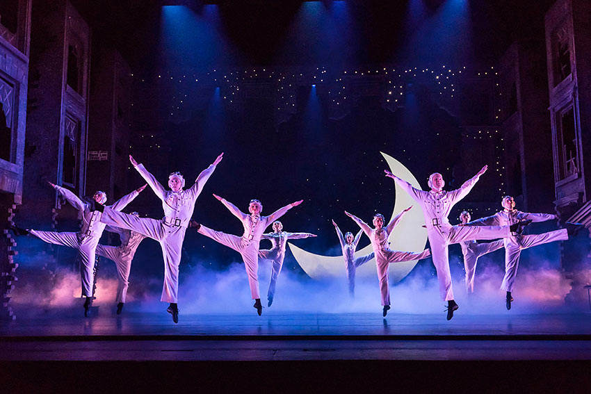 Cinderella dance company in one of the production numbers choreographed by Sir Matthew Bourne