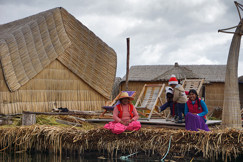 family on a floating reed island, Lake Titicaca, Peru