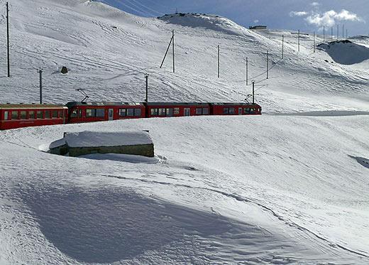 Glacier Express train in winter landscape