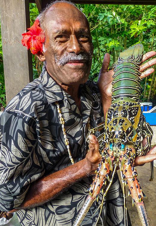 bartender and village elder Manasa with lobster at Yasawa Island Resort, Fiji