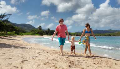 young family at the Mermaid Beach, St. Croix