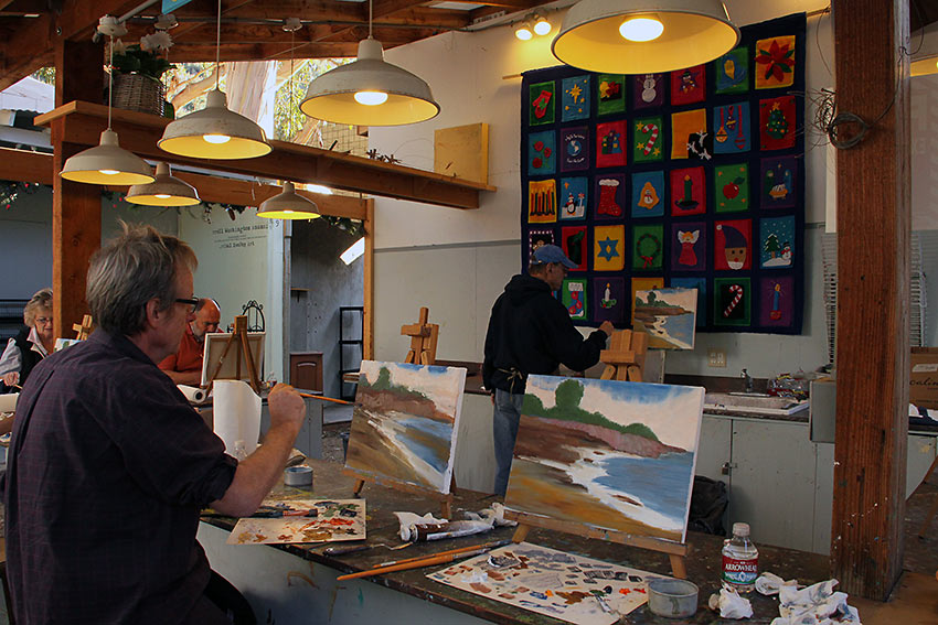 John Eagle conducting a beginner's painting class