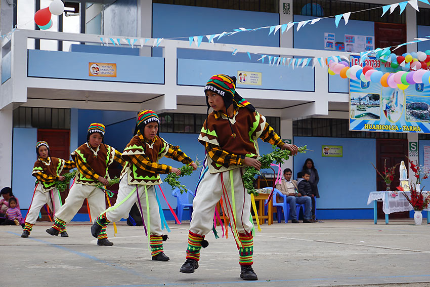 students performing a traditional dance at a primary school anniversary, Peru