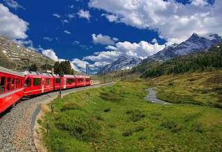 Glacier Express train in Swiss Alps landscape