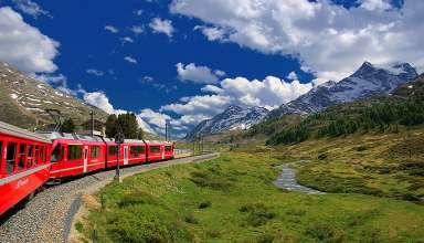 Glacier Express train in Swiss Alps landscape