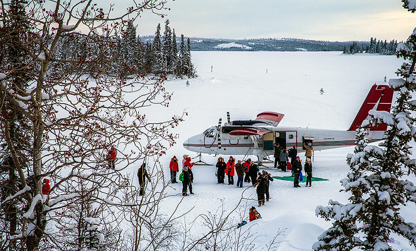 Twin Otter plane with departing and arriving guests, Blachford Lake