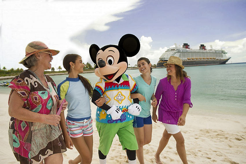 Mickey Mouse with guests on a Disney Cruise Line voyage