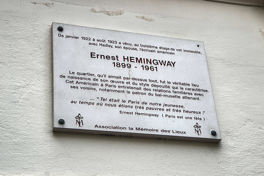 French plaque on a building at the Left Bank in Paris honoring Ernest Hemingway