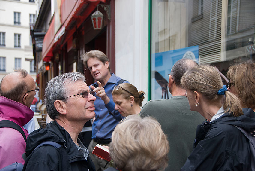 tourists with guide at a Paris Walking Tour