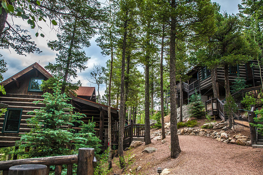 one and two-bedroom rustic log guest cabins near the Lodge