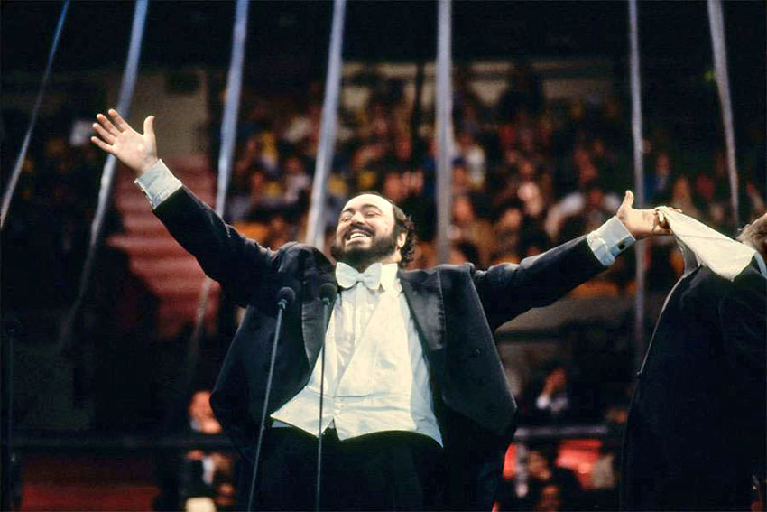 Pavarotti in performance with his signature white handkerchief