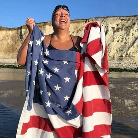 Diana Qualls Corbin with U.S. flag