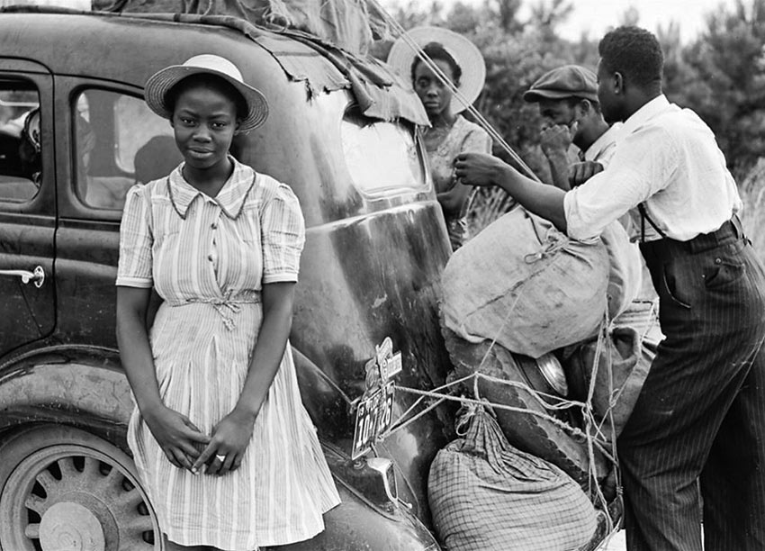 Group of Florida migrants on their way to Cranberry, New Jersey, to pick potatoes. Near Shawboro, North Carolina, July 1940