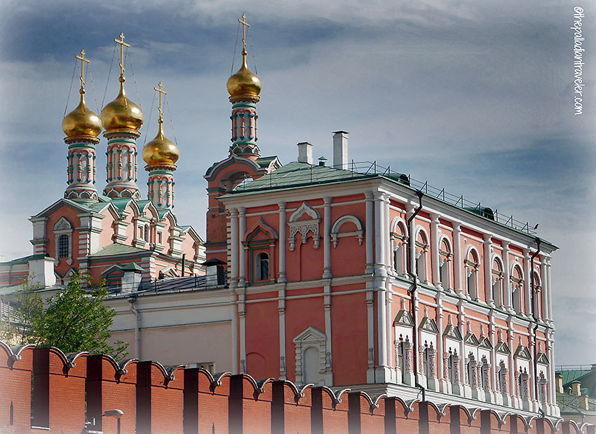 view of the Virgin Church and its four gilded domes behind the Kremlin's walls