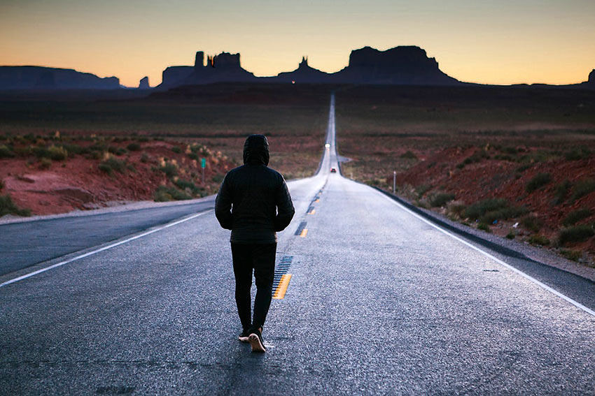 walking on the road to Monument Valley