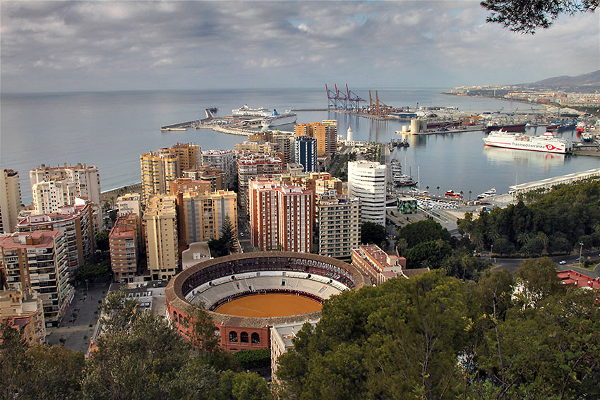 Málaga harbor on the Costa del Sol with the bullring in the foregound