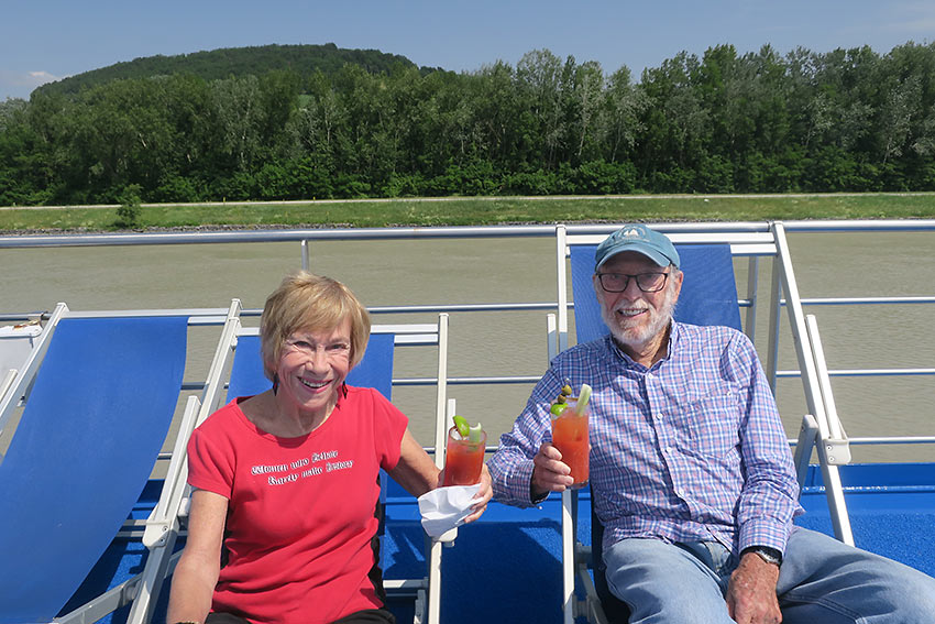 writer and her husband relaxing on deck with Bloody Mary