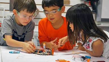 kids with Tinkering Labs set
