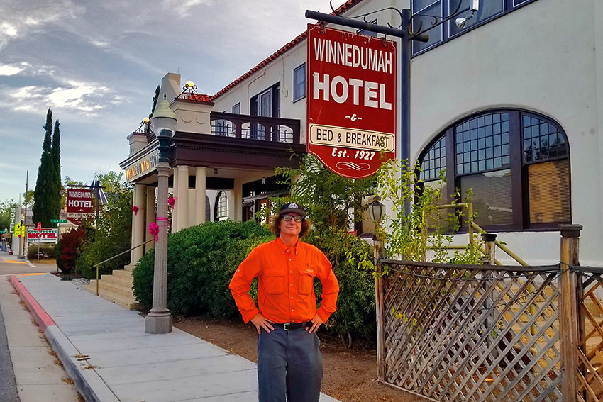 the writer in front of the Winnedumah Hotel, Independence, CA