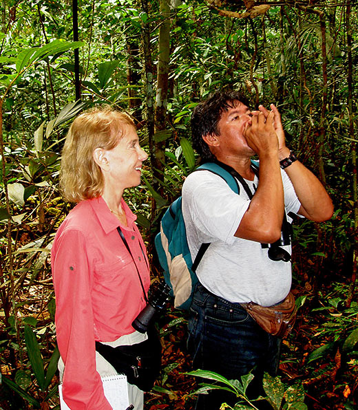 travel guide Souza imitating a bird call