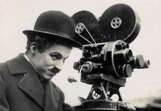 Charlie Chaplin with movie camera