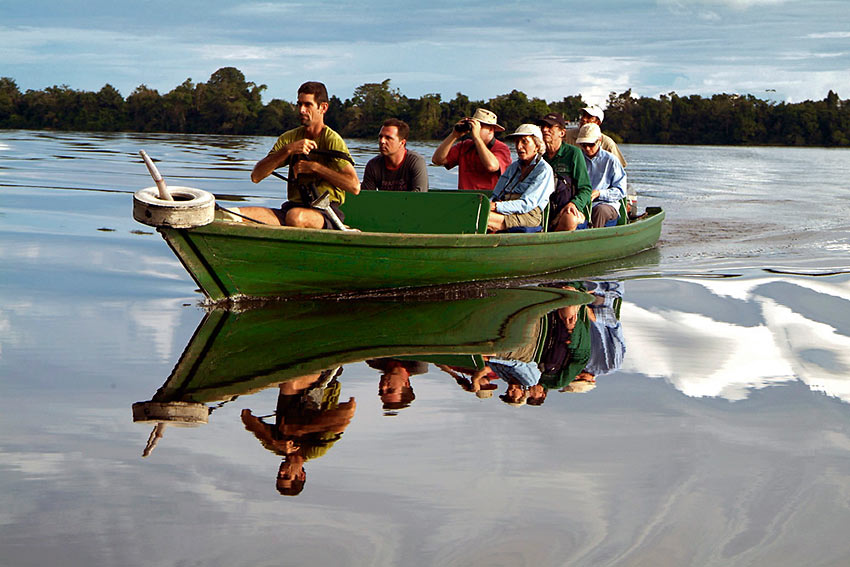 small power launch taking visitors across the River Negro