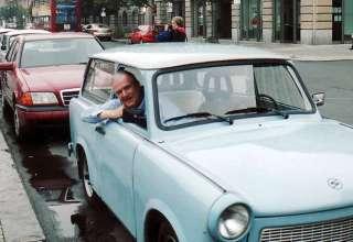 writer John Clayton in a Trabant