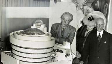 Frank Lloyd Wright with a model of the Guggenheim Museum, 1945