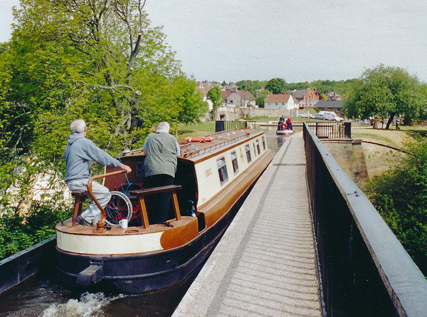 narrowboat on canal bridge