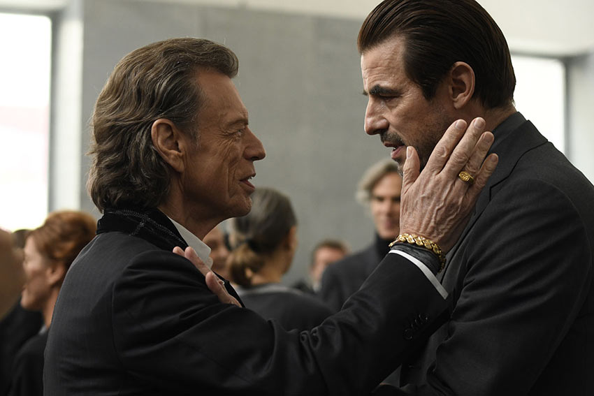 Mick Jagger as Joseph Cassidy and Claes Bang as James Figueras