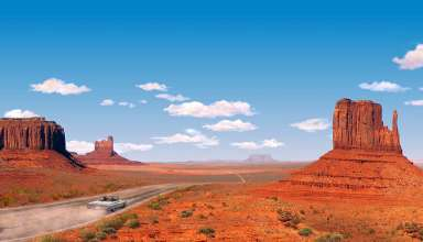 Road Trippers navigate their car through majestic John Ford Country