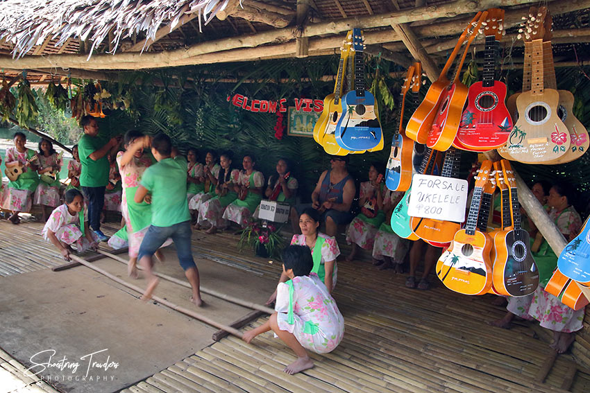 local dancers and musicians performing for visitors on a raft at the Loboc River