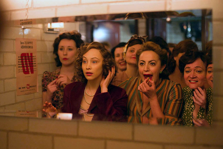 Elizabeth (Sarah Gadon) finds herself in the ladies room